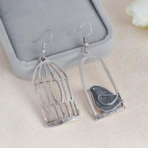 Jewelry - NEW cute bird and cage earrings